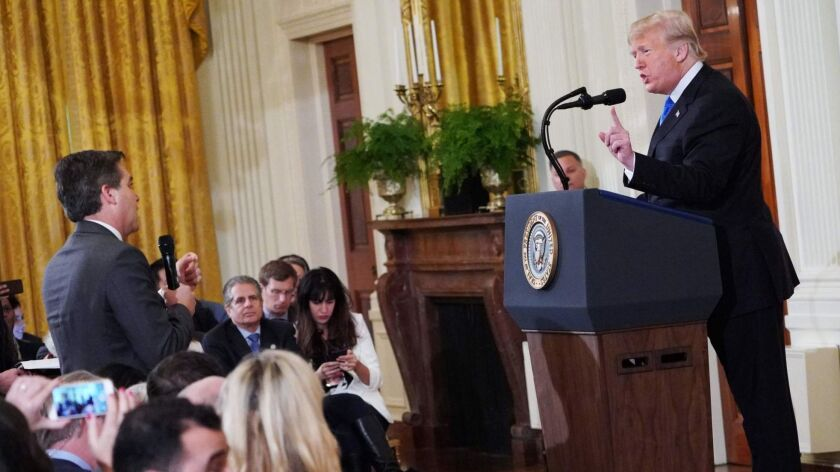 President Trump gets into a heated exchange with CNN chief White House correspondent Jim Acosta on Nov. 7.