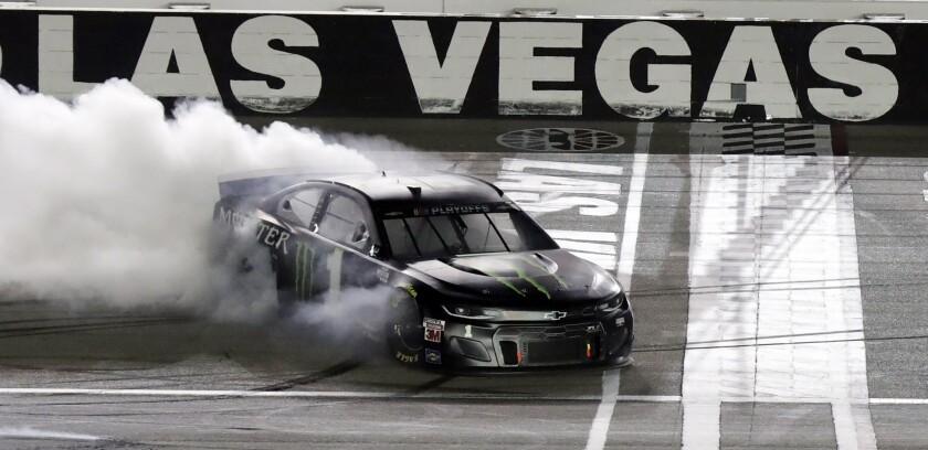 Kurt Busch performs a burnout after winning a NASCAR Cup Series auto race.