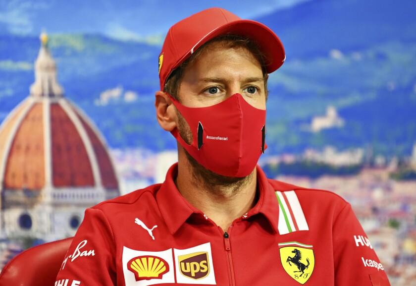 Ferrari driver Sebastian Vettel of Germany attends a media conference at the Mugello racetrack, in Scarperia, Italy, Thursday, Sept. 10, 2020, ahead of Sunday's Formula One Grand Prix of Tuscany. (Clive Mason, Pool Photo via AP)