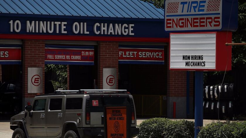 "A ""now hiring"" sign is posted in front of an oil-changing business in Baton Rouge, La., on May 5."