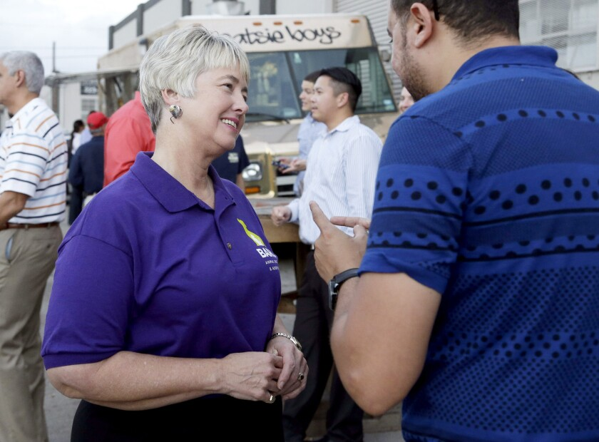 Houston Mayor Annise Parker greets a supporter at a fundraiser for the Houston Equal Rights Ordinance.
