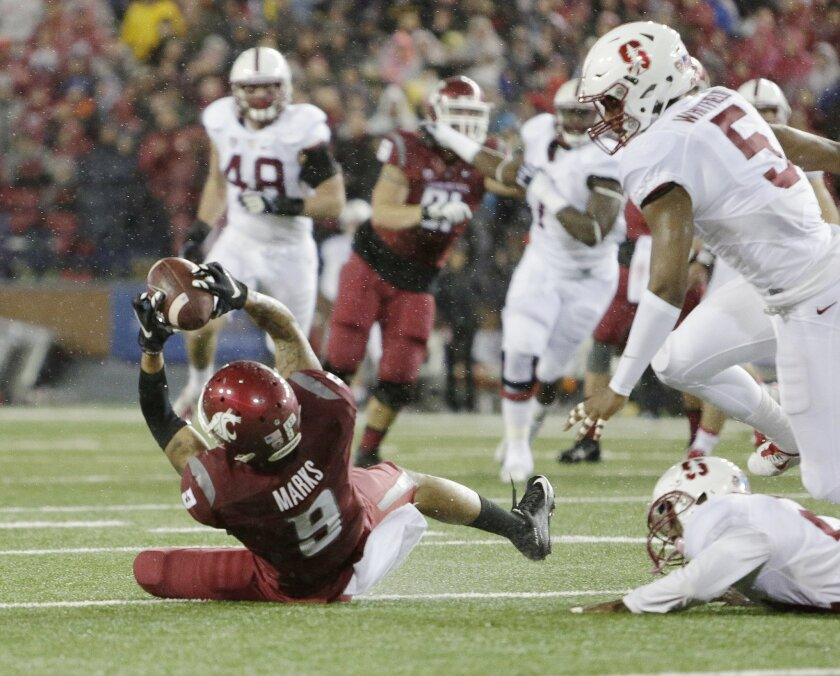 Washington State wide receiver Gabe Marks (9) makes a catch in front of Stanford safety Kodi Whitfield (5) and cornerback Ronnie Harris (21) during the first half of an NCAA college football game, Saturday, Oct. 31, 2015, in Pullman, Wash. (AP Photo/Young Kwak)