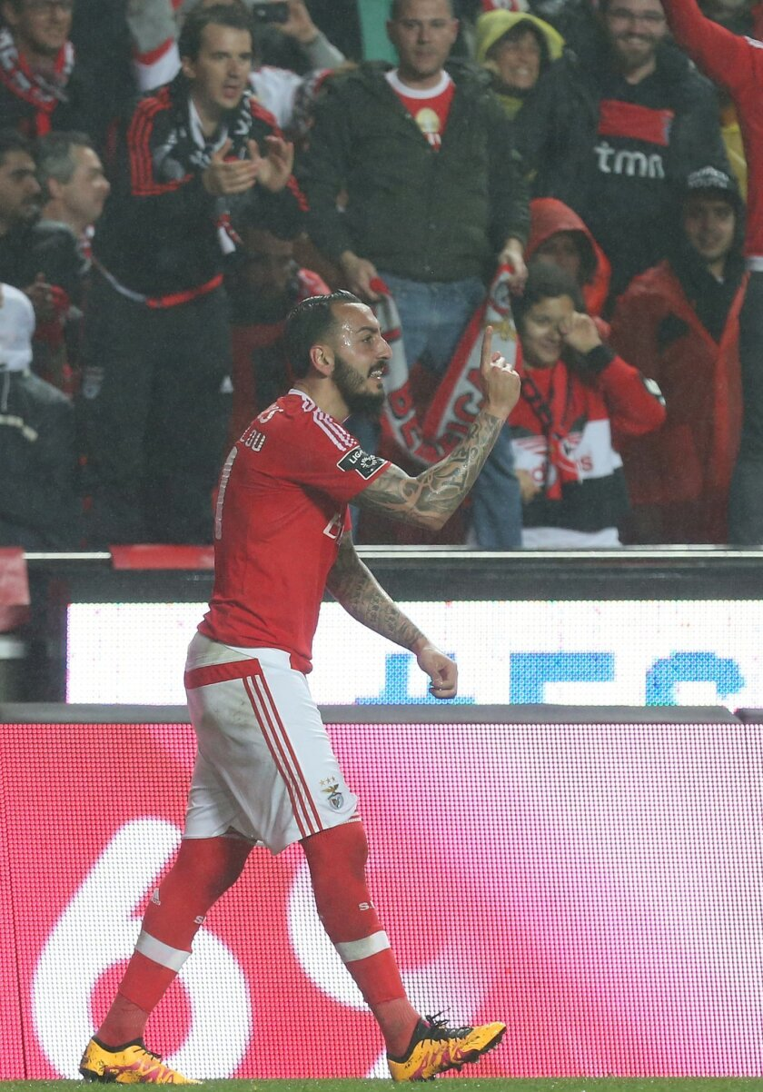Benfica's Kostas Mitroglou celebrates after scoring the opening goal against Porto during their Portuguese league soccer match at Benfica's Luz stadium in Lisbon, Friday, Feb. 12, 2016. (Armando Franca)