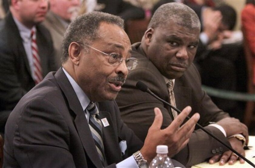 U.S. Senate appointee Roland Burris, left, speaks as his attorney Timothy Wright III listens during the Illinois House Impeachment Committee hearing at the Illinois State Capitol Thursday, Jan. 8, 2009, in Springfield, Ill. (AP Photo/Seth Perlman)