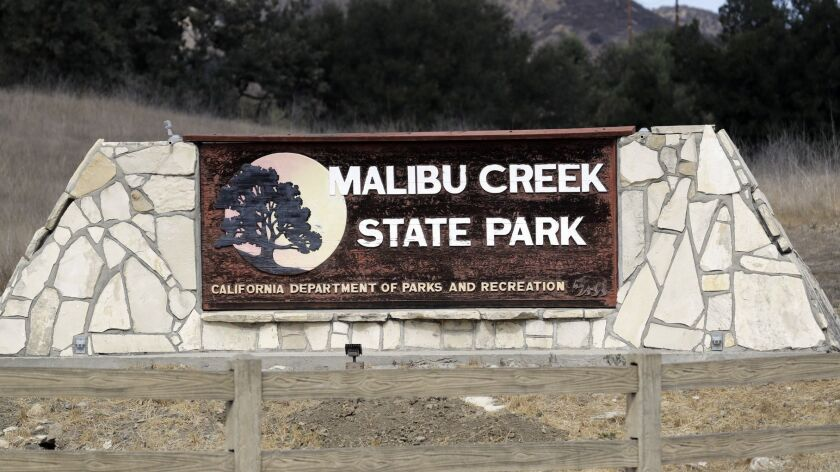 A sign is seen at the entrance to the Malibu Creek State Park Thursday, Oct. 11, 2018, in Calabasas,