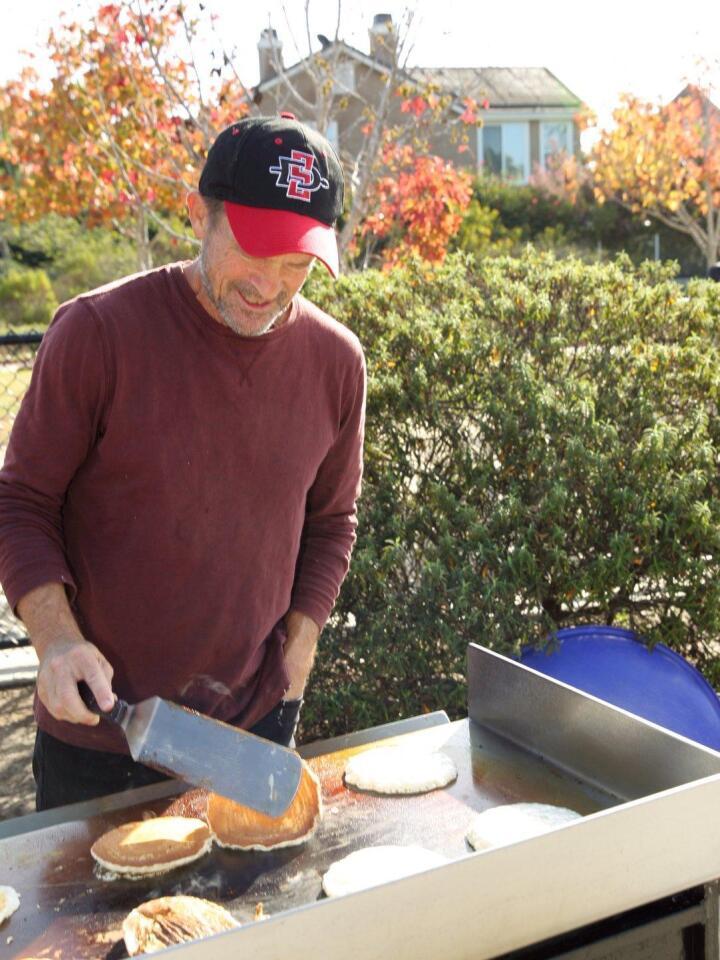 Steve McDowell prepares pancakes