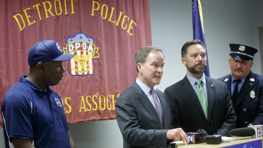 Michigan Atty. Gen. Bill Schuette, center, gestures as he speaks during a campaign event at the Detroit Police Officers Assn. in Detroit on Oct. 4. Schuette is running for governor of Michigan.