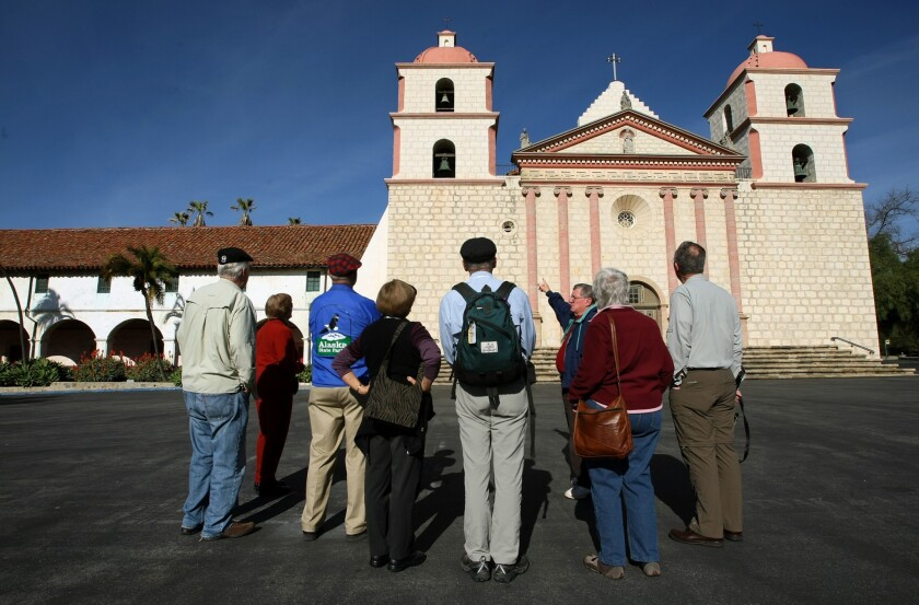 A tour group at the Santa Barbara Mission; Thomas J. Curry, who had a key role in handling of abuse cases, has resigned as bishop for the Santa Barbara region.
