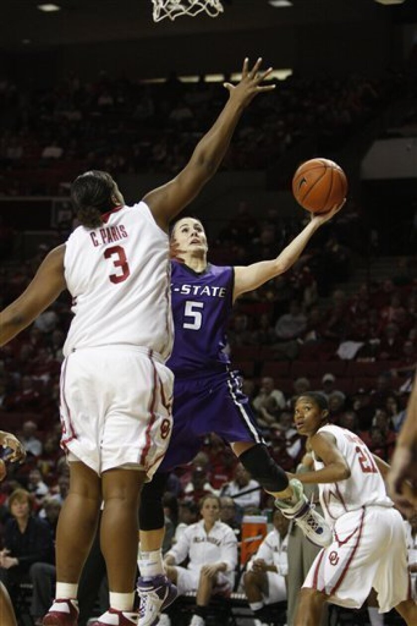 Kansas State guard Shalee Lehning (5) shoots around Oklahoma's Courtney Paris (3) as Oklahoma's Amanda Thompson looks on in the first half of an NCAA college basketball game on Wednesday, Jan. 14, 2009, in Norman, Okla.  (AP Photo/Alonzo Adams)