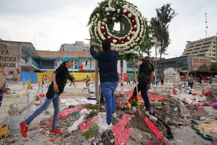 Neighbors, some in shock, volunteers, rescuers, activists and others visited the site of the Chimalpopoca Street factory on Sept. 24, 2017, to pay homage to the dead.