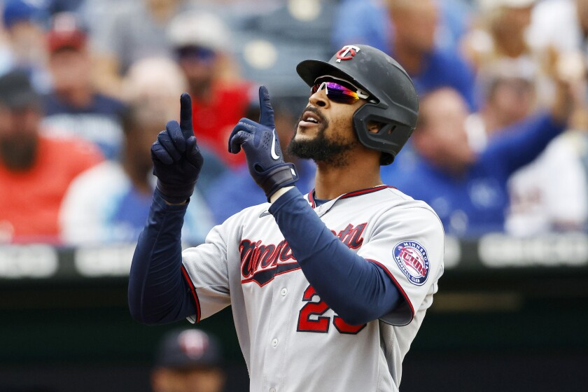 Minnesota Twins' Byron Buxton reacts after hitting a two-run home run during the fifth inning of a baseball game against the Kansas City Royals in Kansas City, Mo., Sunday, Oct. 3, 2021. (AP Photo/Colin E. Braley)