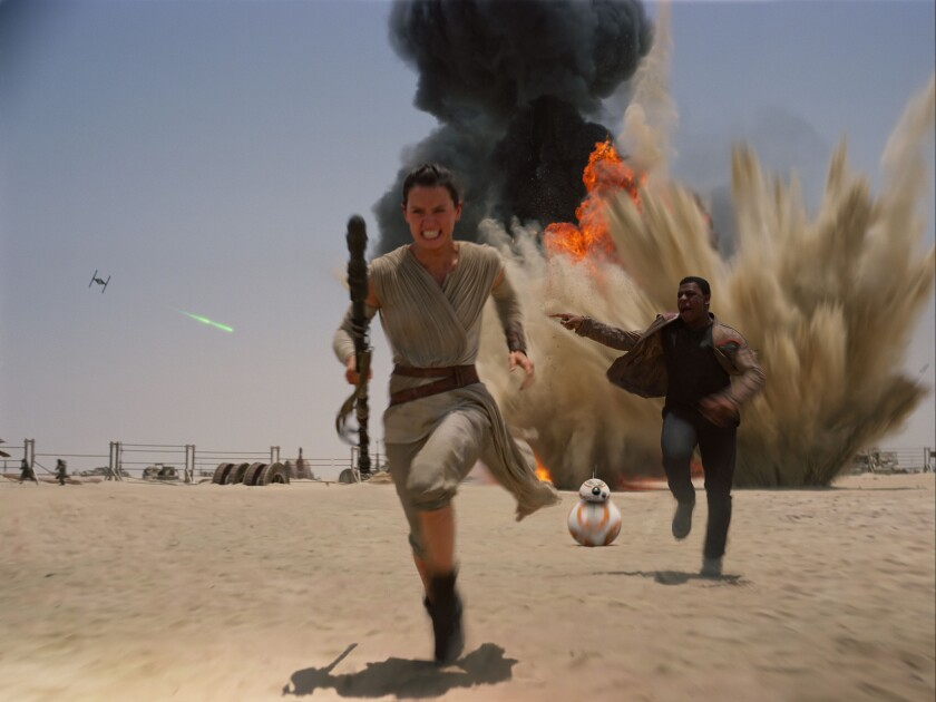 """Daisey Ridley, left, and John Boyega in a scene from the new film, """"Star Wars: The Force Awakens."""""""
