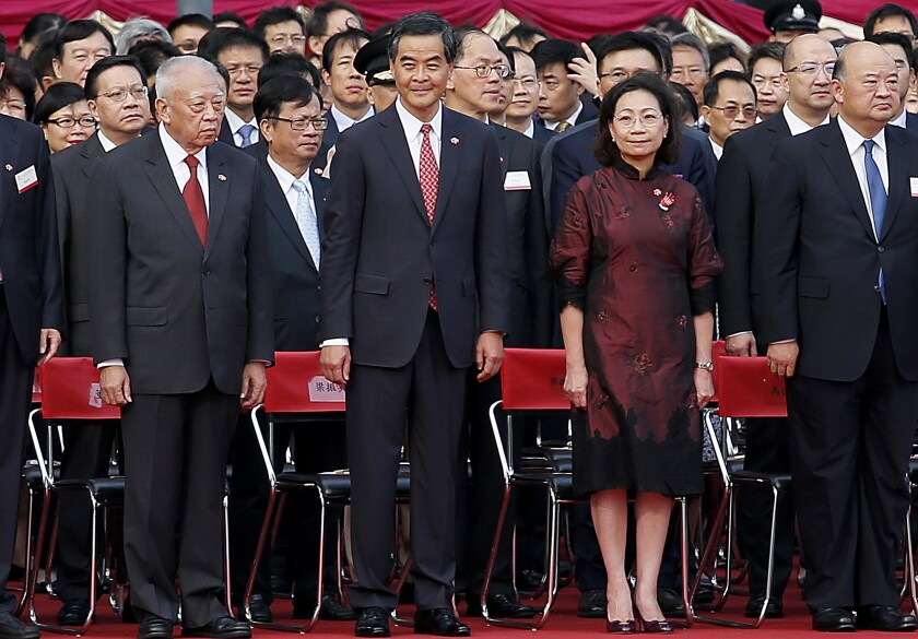 Hong Kong Chief Executive Leung Chun-ying, center, stands when the national anthem of China is played during a flag-raising ceremony in Hong Kong on Oct. 1.