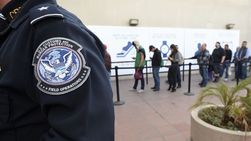 People wait to enter the U.S. at the Otay Mesa Port of Entry in San Diego.