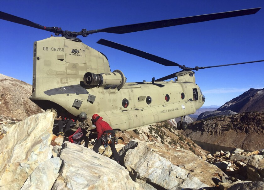 A photo provided by the Mono County Sheriff's Office shows operations Tuesday to recover the bodies of two hikers who died on Red Slate Mountain in the eastern Sierra Nevada.
