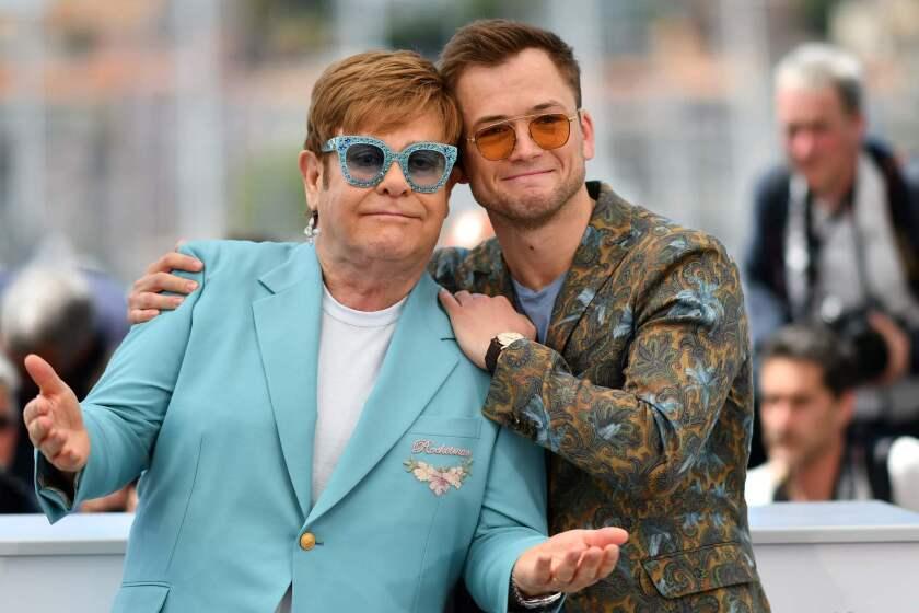 British singer-songwriter Elton John, left, and British actor Taron Egerton
