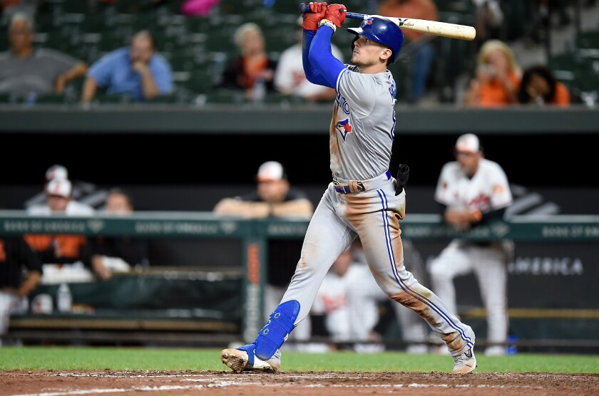 Toronto Blue Jays' Cavan Biggio hits a two-run triple in the ninth inning against the Baltimore Orioles to complete the cycle on Tuesday in Baltimore.