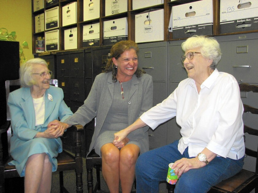 Alice Lee, left, accepts birthday wishes from then-newly elected Monroe County Circuit Judge Dawn Hare, center, and her sister, Pulitzer Prize-winning author Harper Lee, in Monroeville, Ala., in 2006.