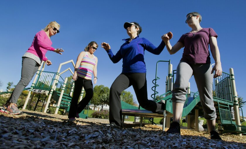 Susan Webster (far left), founder of Pacific Cancer Fitness in Carlsbad, guides cancer survivors through some exercises on Jan. 23. / photo by Nelvin C. Cepeda * U-T San Diego