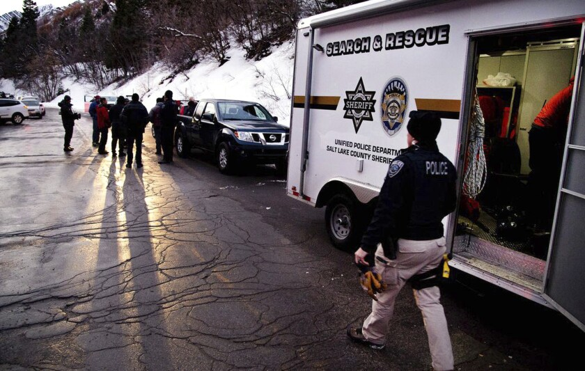 Salt Lake County Sheriff Search and Rescue crews respond to the top of Millcreek Canyon where four skiers died in an avalanche Saturday, Feb. 6, 2021, near Salt Lake City. Four other skiers were injured, authorities said. The Unified Police Department told local media that it was alerted to the avalanche about 11:40 a.m. after receiving a faint distress call from an avalanche beacon in the canyon. The skier-triggered avalanche swept up eight people in their early twenties to late thirties who were in two groups touring the backcountry, Unified Police Sgt. Melody Cutler told the Salt Lake Tribune. (Francisco Kjolseth/The Salt Lake Tribune via AP)