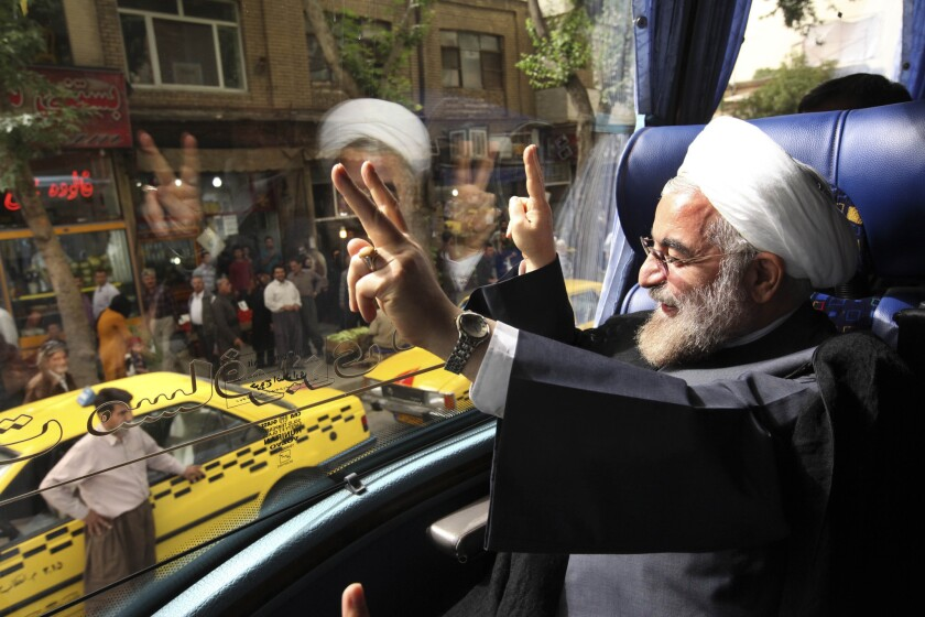 Iranian President-elect Hasan Rouhani waves to supporters.
