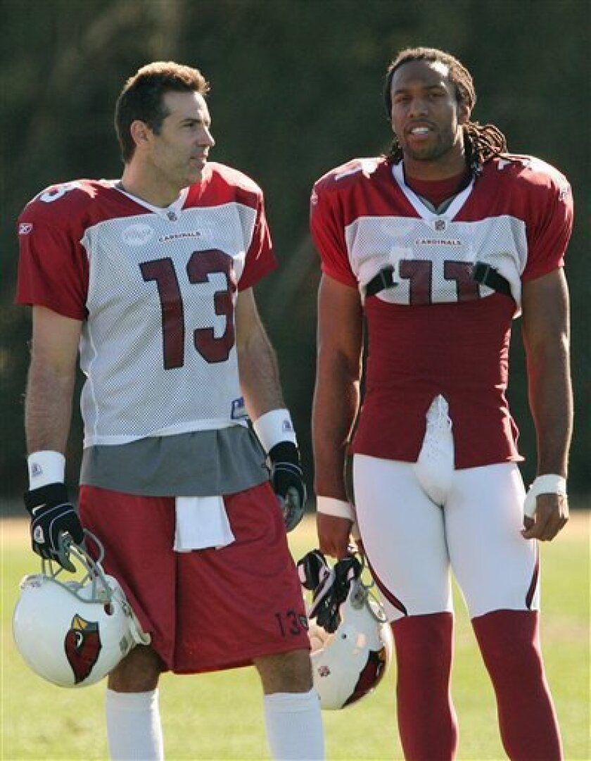 Arizona Cardinals' Kurt Warner (13) and Larry Fitzgerald talk during football practice on Thursday, Jan. 15, 2009, in Tempe, Ariz.  The Cardinals face the Philadelphia Eagles in the NFC Championship football game on Sunday in Glendale, Ariz. (AP Photo/Ross D. Franklin)