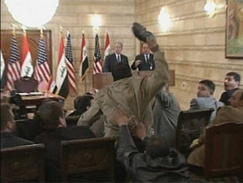 In a Sunday news conference in Iraq, President George W. Bush (left) stood at the podium with Iraq Prime Minister Nouri al-Maliki when journalist Muntather Zaidi, a correspondent for Baghdadiya, a satellite TV channel that broadcasts from Cairo, flung one shoe and then another at Bush. The president ducked and wasn't hit by the flying footwear.