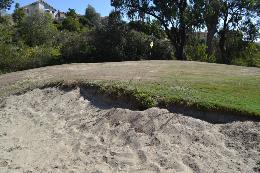 The poorly maintained bunker and brown green of the first hole are representative of how much the Town Park Villas Golf Course fell into disrepair in recent years.