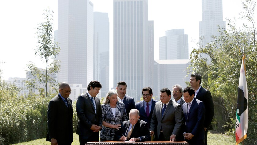 Gov. Jerry Brown joins legislative, environmental, business and community leaders in Los Angeles to sign SB 32 by Sen. Fran Pavley (D-Agoura Hills) and AB 197 by Assemblyman Eduardo Garcia (D-Coachella).
