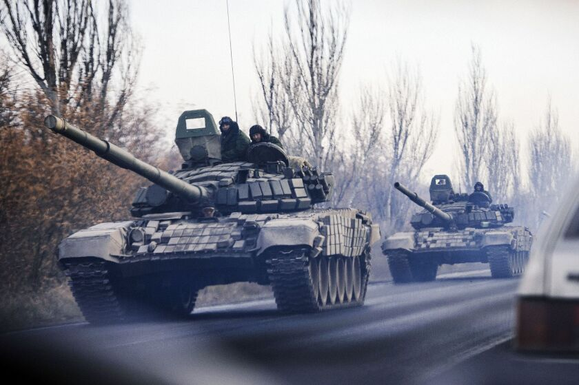 A column of tanks moves westward near the eastern Ukraine town of Shakhtarsk on Monday, part of a new influx of weapons and fighters seen by monitors of the Organization for Security and Cooperation in Europe.