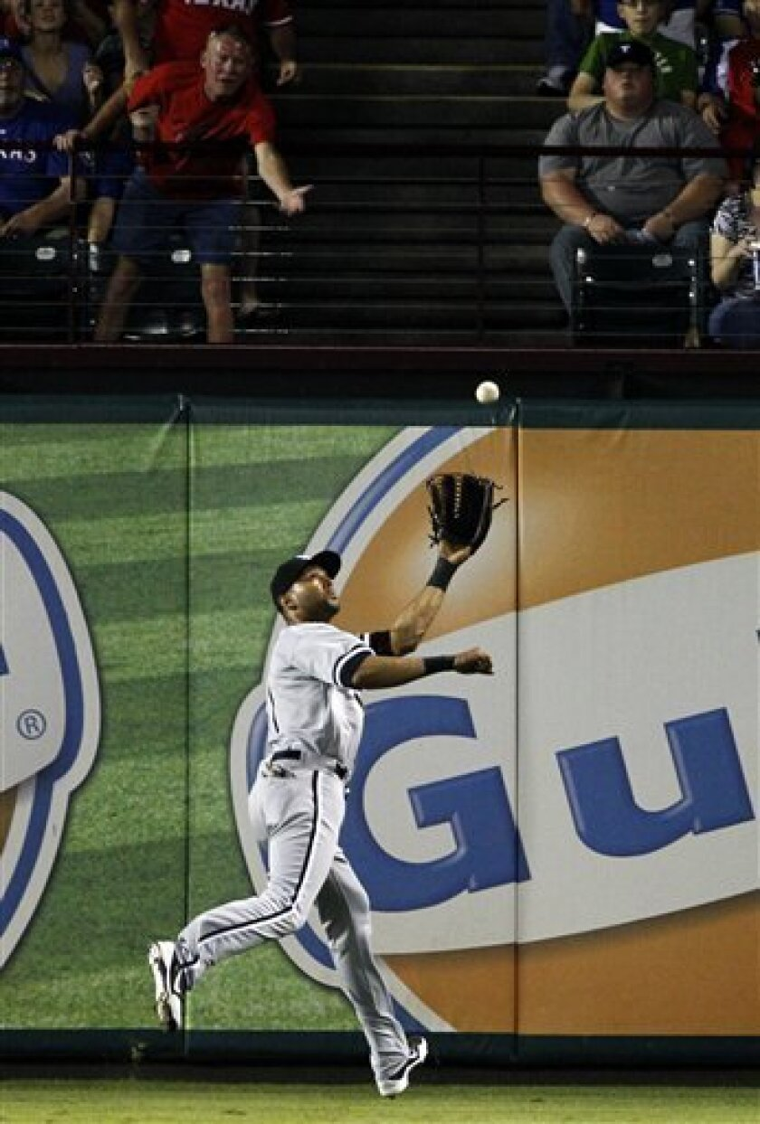 Chicago White Sox center fielder Alex Rios (51) chases down a fly-out by Texas Rangers' Ian Kinsler in the fourth inning of a baseball game on Saturday, April 7, 2012, in Arlington, Texas. (AP Photo/Tony Gutierrez)