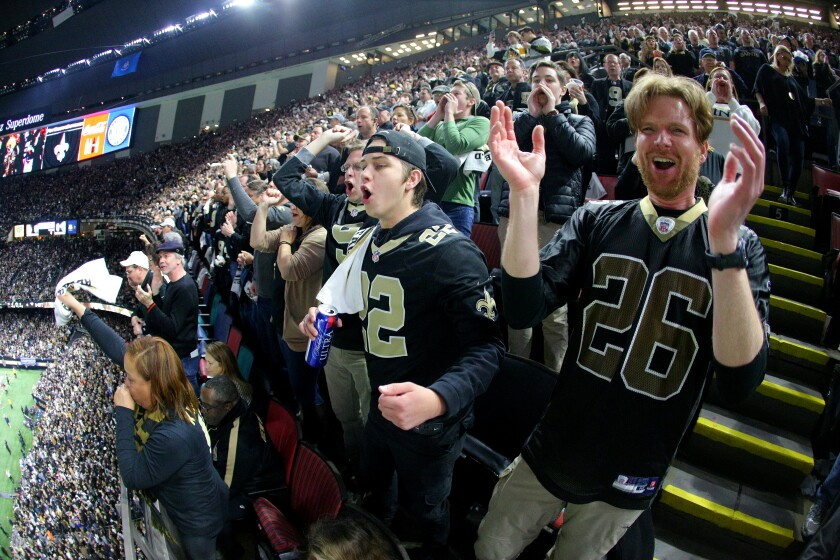 New Orleans Saints fans cheer during the first quarter in the NFC championship game at the Mercedes-Benz Superdome on Jan 20.
