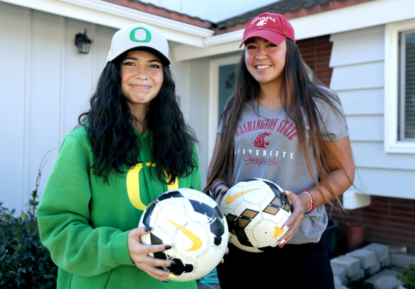 Marina  soccer teammates Kaitlyn Paculba, left, and McKenna Pua committed to Oregon and Washington State, respectively.