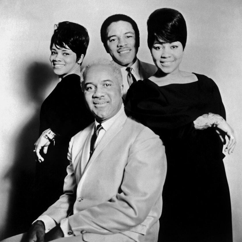 Mavis Staples, Pervis Staples, Cleotha Staples and Roebuck 'Pops' Staples pose in 1965.