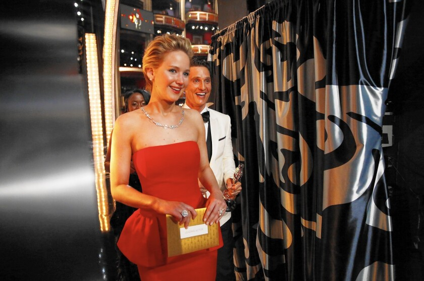 Jennifer Lawrence, shown at the 2014 Academy Awards, has declared war on the curse of likability that she says helps sustain Hollywood's gender wage gap.