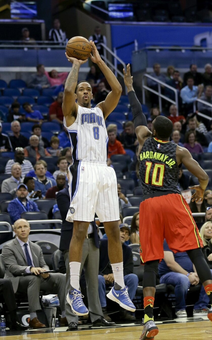 FILE - In this Feb. 7, 2016, file photo, Orlando Magic's Channing Frye (8) shoots over Atlanta Hawks' Tim Hardaway Jr. (10) during the first half of an NBA basketball game, in Orlando, Fla. Two people with knowledge of the deal say the Cavaliers have acquired forward Channing Frye from the Orlando