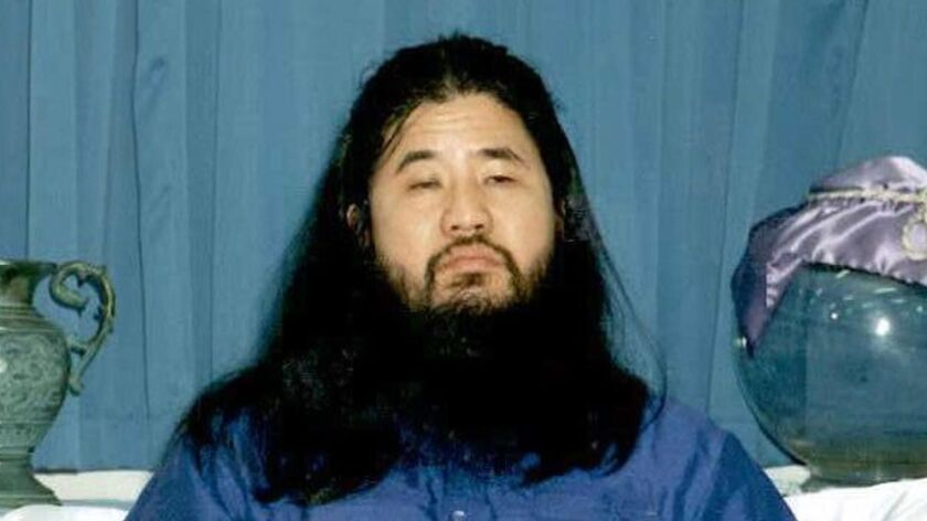 File photo from 1990 shows Shoko Asahara, guru of the doomsday Aum Shinrikyo cult, which carried out a deadly sarin attack on Tokyo's subway in 1995. He was executed Friday.