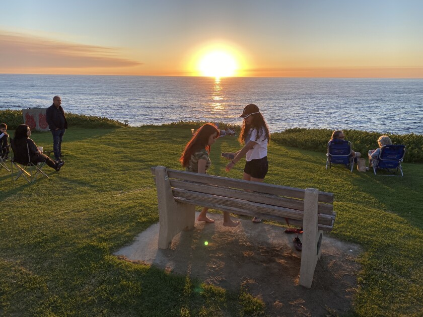 Three groups await the sunset at the grassy area adjacent to the Wedding Bowl (Cuvier Park).