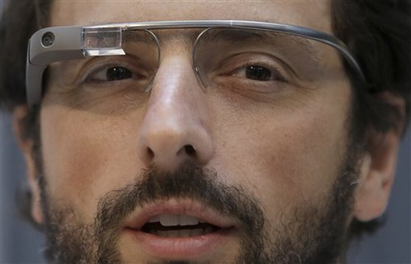 Google co-rounder Sergey Brin wears Google Glass glasses at an announcement for the Breakthrough Prize in Life Sciences at Genentech Hall on UCSF's Mission Bay campus in San Francisco, Wednesday, Feb. 20, 2013. (AP Photo/Jeff Chiu)