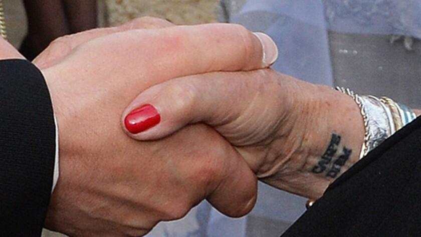 """Judi Dench's right-wrist tattoo reads """"Carpe Diem."""""""