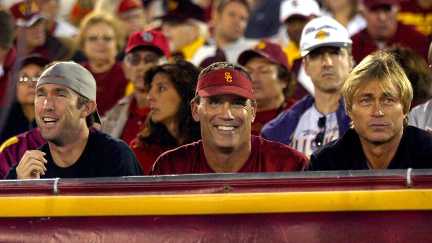 Former Trojan football player Riki Ellison watches USC play Washington during a Pac-12 game at the Coliseum.