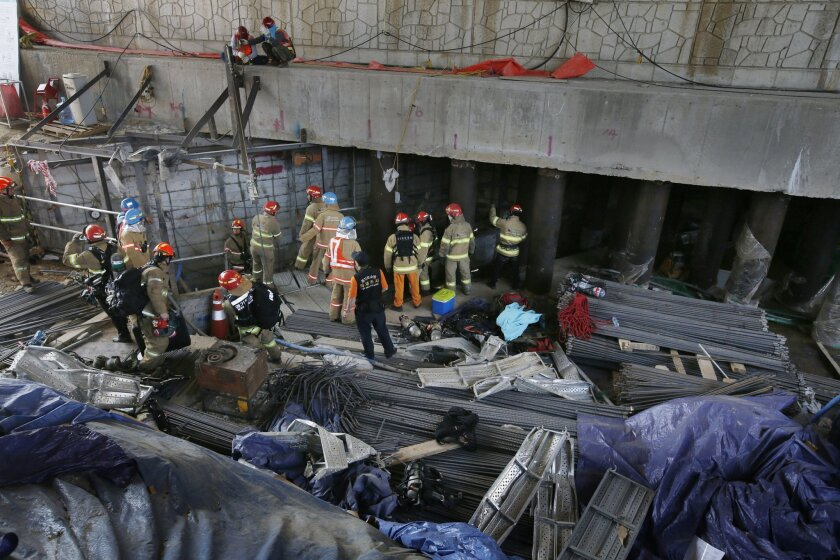 Rescue workers search for survivors after an explosion at a subway construction site in Namyangju, South Korea, Wednesday, June 1, 2016. Officials from the Gyeonggi Province Fire and Disaster Headquarters said the workers were underground when the explosion occurred Wednesday morning. (Lim Byung-shick/Yonhap via AP) KOREA OUT