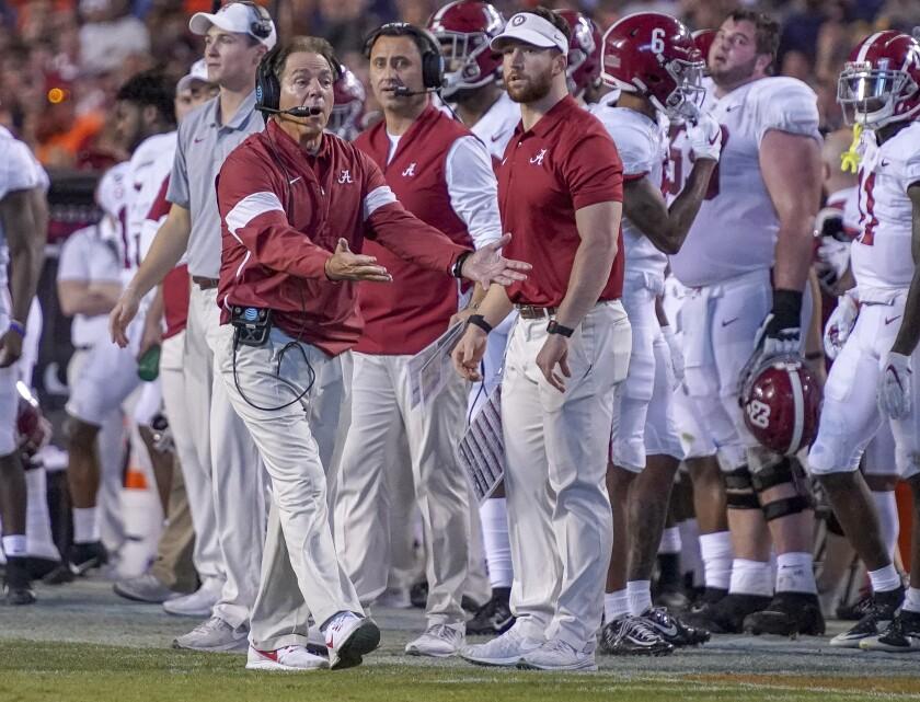 Alabama head coach Nick Saban disagrees with a call in the second half of an NCAA college football game against Auburn in Auburn, Ala., on Saturday, Nov. 30, 2019. (Chris Shimek/The Decatur Daily via AP)