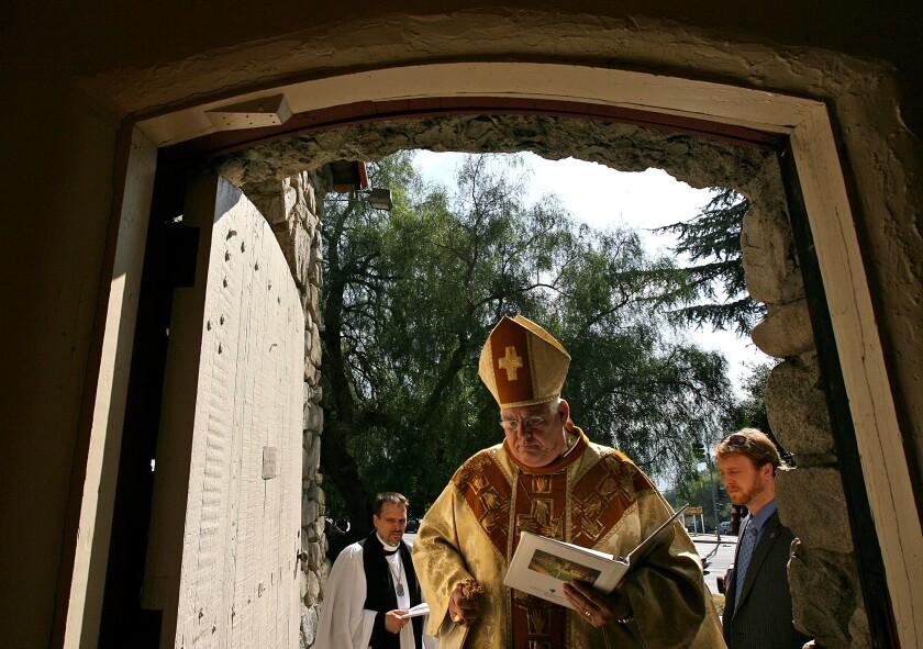 Bishop J. Jon Bruno enters a church in 2009.