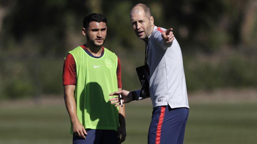 U.S. coach Gregg Berhalter, right, instructs player Cristian Roldan during a training camp on Jan. 7 in Chula Vista.