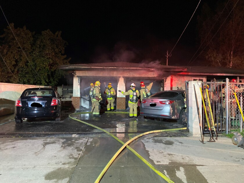 Escondido firefighters rescued two pets from a fire that spread from the garage into a house in Escondido Friday night.