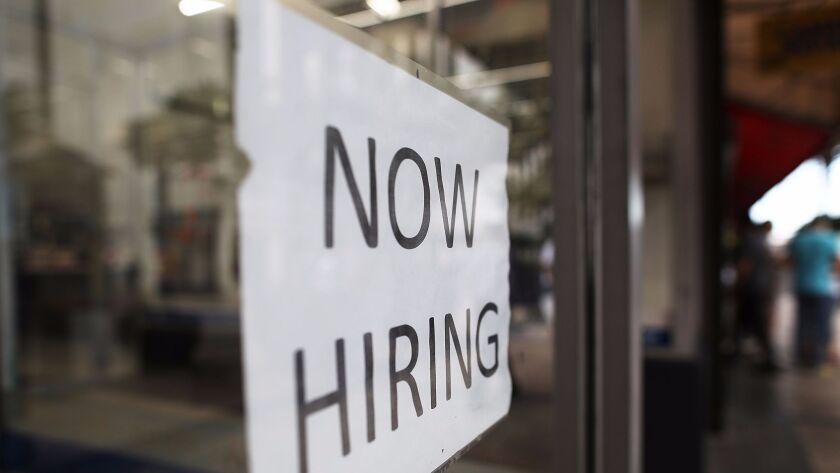 MIAMI, FL - MARCH 10: A Now Hiring sign is seen as the Bureau of Labor Statistics reports that nonf