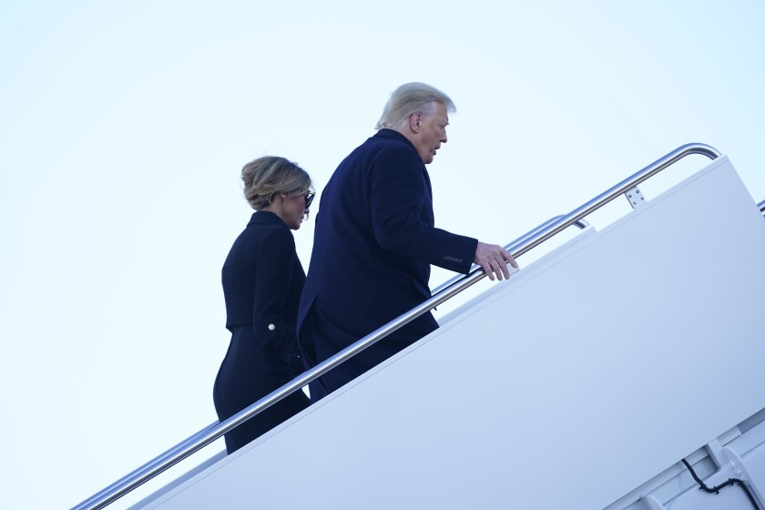 President Trump and First Lady Melania Trump board Air Force One at Andrews Air Force Base, Md., hours before his term ended