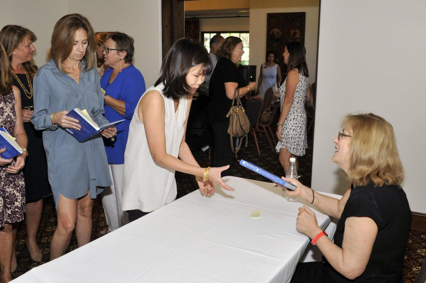 Author Alice Hoffman autographs her book