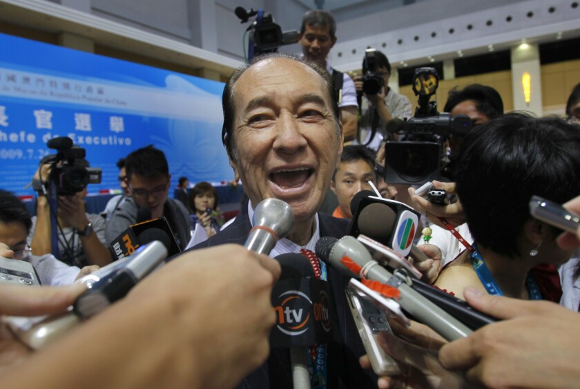Macao casino tycoon Stanley Ho talks to reporters in July 2009. His family says Ho has died at 98.
